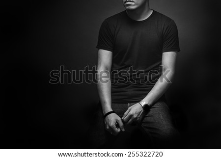 Scary evil man with in darkness - stock photo