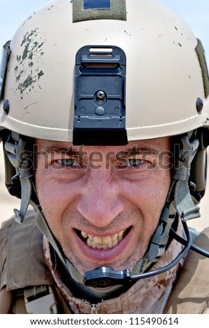 Scary face of US marine in the MARPAT uniform showing teeth