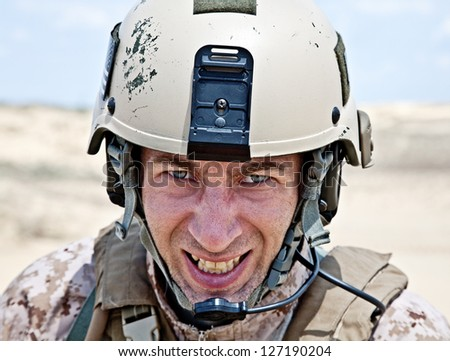 Scary face of US marine in the MARPAT uniform showing teeth - stock photo