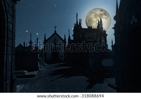 Scary graveyard halloween background in a full moon night - stock photo
