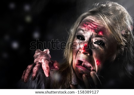 Scary halloween horror. Zombie in pitch black forest expressing fear when getting attacked from evil thing