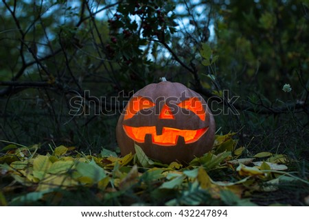 Scary Halloween pumpkin and the old Board for text - stock photo