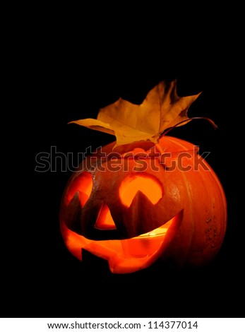 Scary halloween pumpkin jack-o-lantern on black background - stock photo