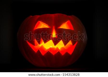 Scary halloween pumpkins jack-o-lantern candle lit. Autumn holidays concept - stock photo
