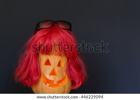 Scary Halloween pumpkins with red hair and - stock photo