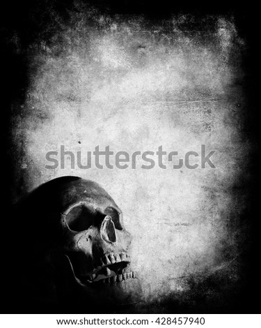 Scary halloween wallpaper with skull. Grunge textured background with faded central area for your text or picture - stock photo