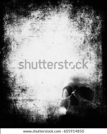 scary halloween wallpaper with skull grunge textured background with frame and faded central area for