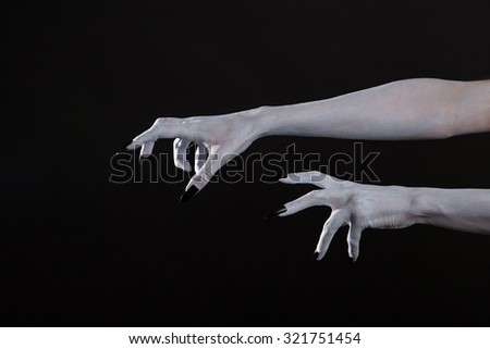 Scary Halloween white hands with black nails, body art - stock photo