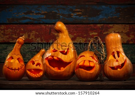 Scary Jack O Lantern Halloween pumpkins in darkness - stock photo