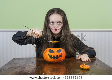 Scary lady having a Halloween dinner