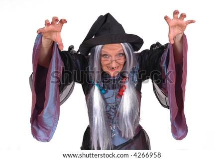 Scary looking Halloween witch, raised arm, clawed hands , holiday, fear concept