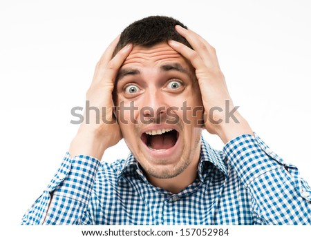 scary man clapped his hands behind his head - stock photo