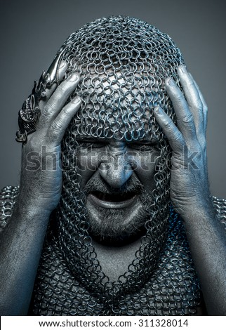 Scary, medieval executioner mesh iron rings on the head - stock photo