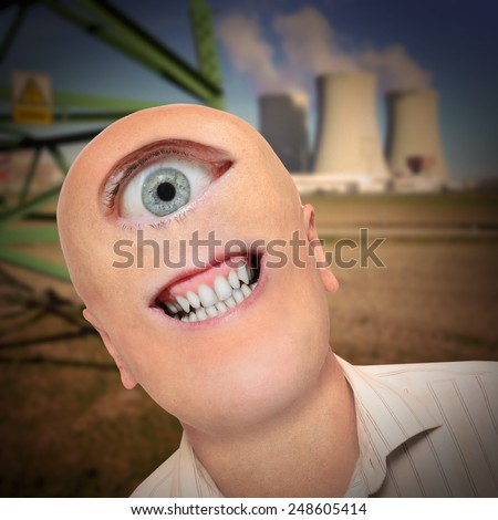 Scary mutant against nuclear power plant. Ecology metaphor. - stock photo