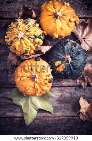 Scary orange pumpkins on wooden background,halloween concept  - stock photo