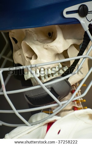 scary skull in a protective sports helmet - stock photo