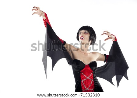 Scary vampire woman with opened mouth looking up. Isolated on pure white background. - stock photo