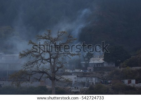 Scary View with Little Houses and Smoke