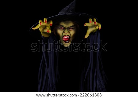 Scary wicked witch trying to catch viewer, Halloween concept