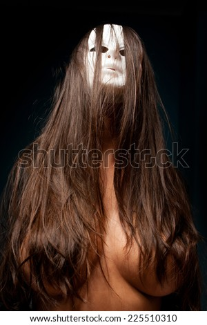 scary woman with white mask  - stock photo