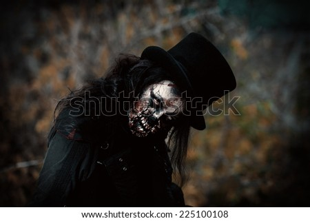 Scary zombie girl standing outdoor. Sugar skull. Halloween.  - stock photo