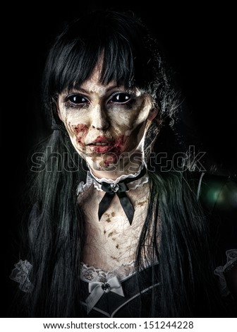 Scary zombie woman  with black eyes and bloody mouth - stock photo