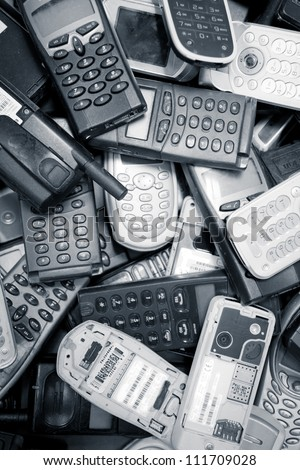 scatered mobile phones color processed - stock photo
