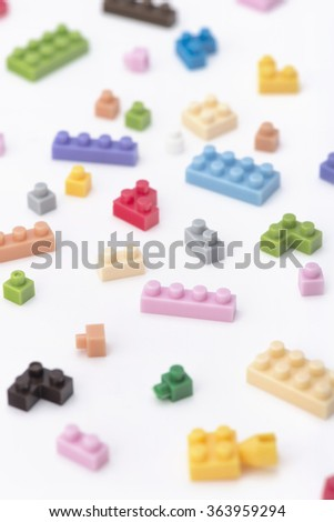 scatter mini lego block background - stock photo