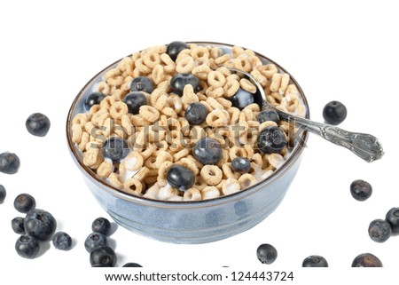 Scattered Blueberries and cereal on a ceramic bowl - stock photo