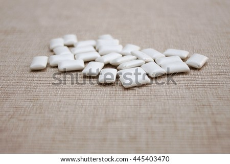 Scattered chewing gum pills