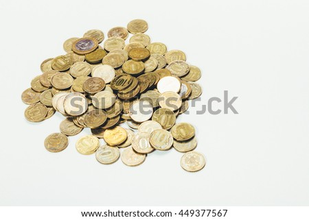 scattered coins on a white surface