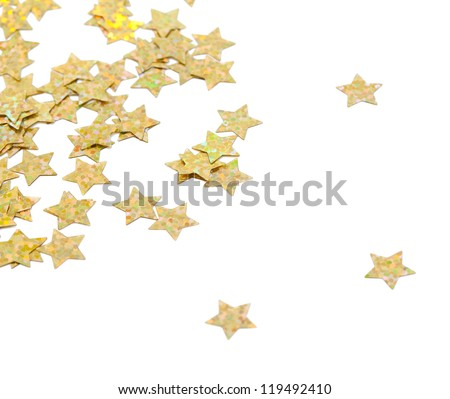scattered glittering stars confetti isolated on white background - stock photo