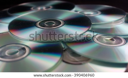 Scattered pile of CDs on a black background. - stock photo