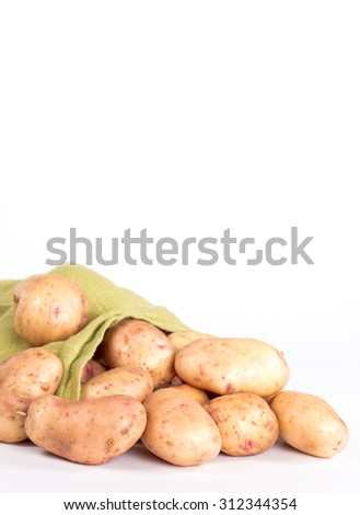scattered potatoes in bag isolated on white background