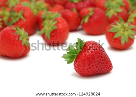 Scattered ripe strawberry isolated on white background - stock photo