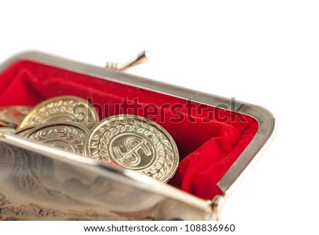 Scattered silver and gold coins are in open hot red purse, isolated on white background. A great number of coins symbolize wealth, richness, income and profit. Close up shot. - stock photo