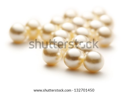 Scattering white pearls on white - stock photo
