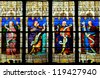 SCEAUX, FRANCE - OCTOBER 7: Stained glass windows depicting Isaiah, Jeremiah, Ezekiel, Daniel at St. Jean-Baptiste Church on October 7, 2012 in Sceaux. - stock photo