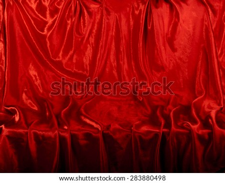 Scene-background with red velvet (chaotic folds). - stock photo