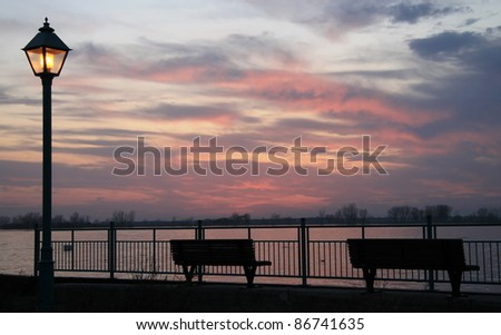 Scene for a romantic waterside sunset evening - stock photo