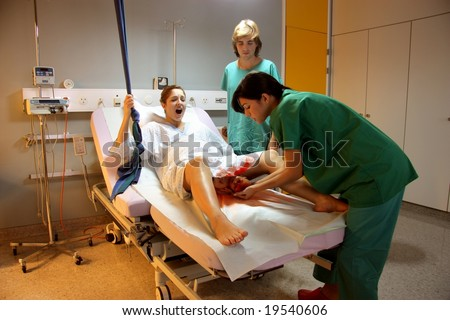 scene in delivery room - stock photo