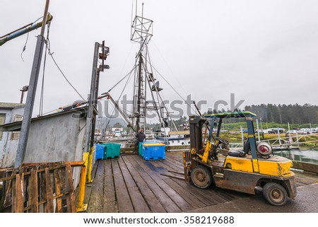 scene of fisherman transfer fish in fishing dock  in the morning. - stock photo