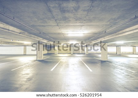 scene of  interior in cement Parking lot  with empty people in the mall.