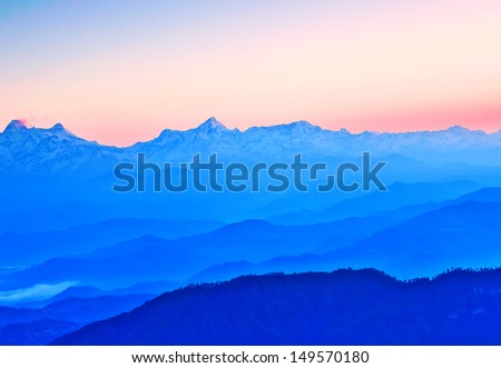 scene of mountains during early sunrise - stock photo