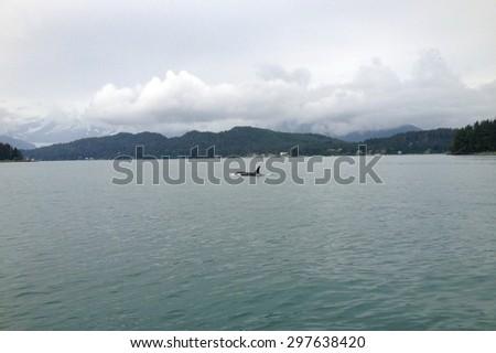Scene of the Gastineau Channel near Juneau, Alaska. - stock photo
