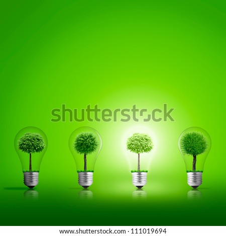 Scene of the light from lightbulb with tree inside - stock photo