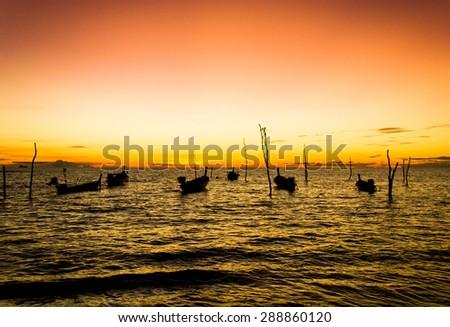 Scene under the Setting Sun On a Sunset Beach  - stock photo
