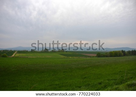 Scenery background of green field and nature mountain background