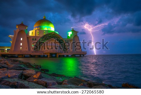 Scenery during sunrise and capture the lightning of Malacca Straits Mosque (Masjid Selat Melaka). This is a mosque located on Malacca Island near Malacca Town in Malacca state Malaysia.  - stock photo