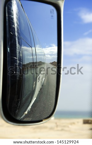 Scenery in the Auto rearview mirror - stock photo